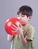 Boy and red balloon. Stock Photos