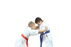Boy with red belt are perfoming capture judogi the sportsman with blue belt Royalty Free Stock Photos