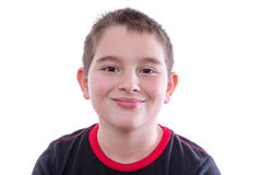 Boy in Red and Black T-Shirt Smiling at Camera Royalty Free Stock Images