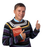Boy with red book showing thumbs up. Young boy with red book showing thumbs up Royalty Free Stock Photo