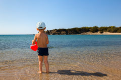 Boy with red bucket Stock Image