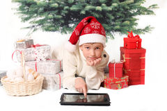 The boy in red cap points into tablet PC monitor Stock Photos