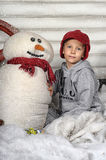 Boy with a snowman with studio royalty free stock photos