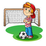 Boy in a red cap and striped t-shirt  with a soccer ball and foo Royalty Free Stock Image