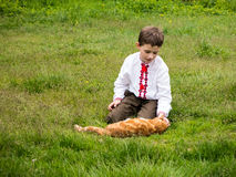 A boy with a red cat Stock Photography