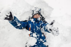 A boy in the snow stock photography
