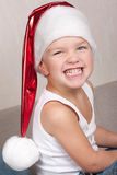 Boy in red christmas hat Stock Images