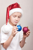 Boy in red christmas hat Stock Photography