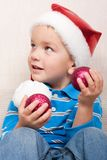 Boy in red christmas hat Royalty Free Stock Photo