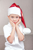 Boy in red christmas hat Royalty Free Stock Image
