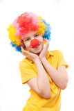 The boy with a red clown nose Stock Images