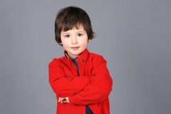 Boy in red with crossed arms Royalty Free Stock Photo