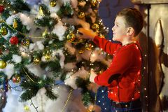 Boy at the Christmas tree Stock Images