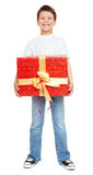 Boy with red gift box and golden bow - holiday object concept isolated Royalty Free Stock Photography