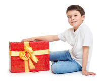 Boy with red gift box and golden bow - holiday object concept isolated Royalty Free Stock Image