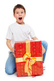 Boy with red gift box and golden bow - holiday object concept isolated Stock Photo