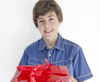 Boy with red gift Stock Image