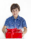 Boy with red gift Royalty Free Stock Photo