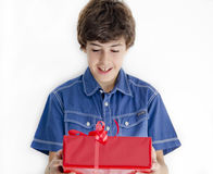 Boy with red gift Stock Photos