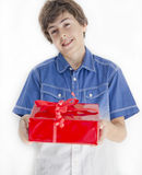 Boy with red gift Stock Photography