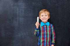 Boy with red hair looking forward far classwork Royalty Free Stock Photo