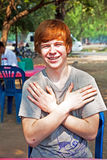 Boy with red hair and pickax in the face looks happy Stock Image