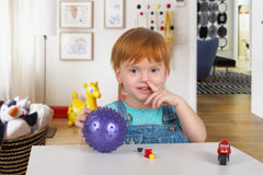 The boy with red hair  picks a nose Stock Images