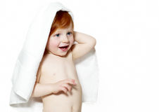 Boy with red hair under a terry towel Stock Images