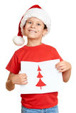 Boy in red hat with letter to santa - winter holiday christmas concept Stock Photography