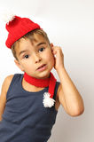 Boy in a red hat and scarf Stock Photography