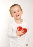 Boy with red heart Stock Photo