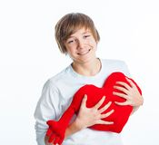 Boy with red heart Stock Photos