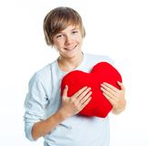 Boy with red heart Stock Images