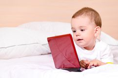 Boy with red laptop Royalty Free Stock Photography