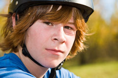 Boy with red long hair and helmet Royalty Free Stock Photo