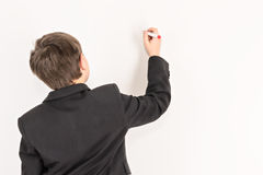 Boy with a red marker Stock Images
