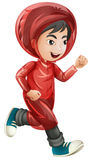 Boy in red raincoat running Royalty Free Stock Photos