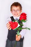 Boy with red rose and heart Royalty Free Stock Image