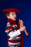 Boy in red scarf and beret with a spyglass Stock Photos