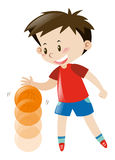 Boy in red shirt bouncing basketball Royalty Free Stock Images