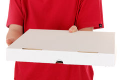 Boy in red shirt delivers a pizza box stock image