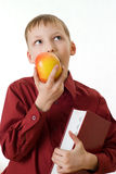 Boy in a red shirt eating an apple Royalty Free Stock Photos