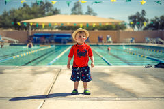 Boy on Red Shirt Beside Swimming Pool during Daytime Stock Photography
