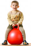 Boy on red sphere Royalty Free Stock Photography