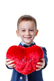 Boy with red symbolic heart, on white background. Royalty Free Stock Images