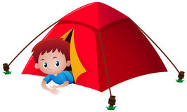 Boy in red tent Royalty Free Stock Photos