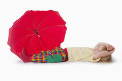 Boy with red umbrella Stock Photography