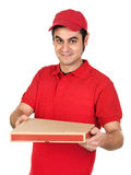 Boy with red uniform delivering a pizza box. Isolated on white background royalty free stock photos