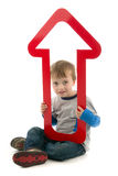 Boy with red upward arrow Stock Photo