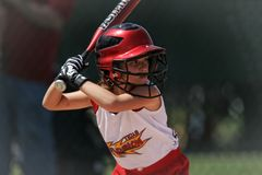 Boy in Red and White Baseball Jersey Tilt Shift Lens Photography Royalty Free Stock Images
